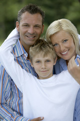 Boy with his parents.