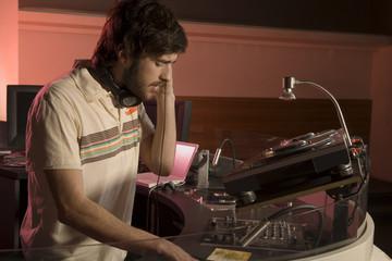 A DJ playing at a nightclub.