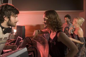 A woman talking to a DJ