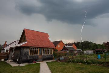 Lightning over the houses