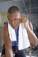 Man listening to music in the gym.