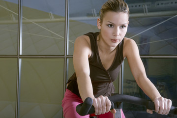 Woman exercising in the gym.