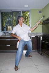Man playing air guitar with mop