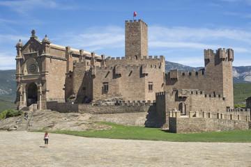 a woman looking the San Javier Castle, Spain