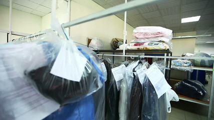 Rack with clean clothes at dry cleaners