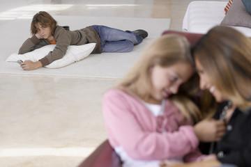 Teenage boy lying down
