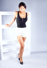 Attractive young woman posing in studio