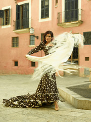 Young woman holding a shawl and dancing