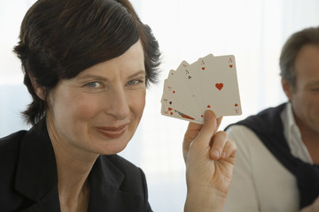 Portrait of a woman showing playing cards