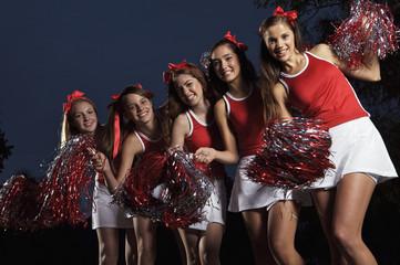 Portrait of cheerleaders dancing and smiling