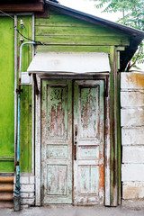Ancient wooden door in old house wall. Astrakhan, Russia