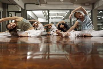 Five young women exercising