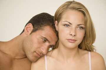 Close-up of a young man romancing with a young woman