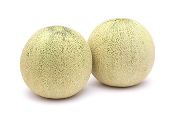 Two musk melons isolated on white background