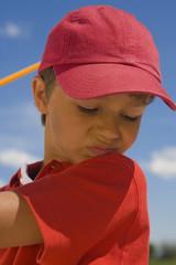 Close-up of a boy swinging a golf club