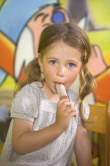 Portrait of a girl eating an ice cream