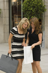 Young women looking in shopping bag