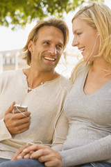 Close-up of a young couple listening to an MP3 player