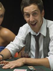 Happy man at poker game