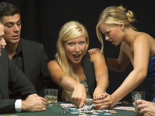 Women fighting over poker chips
