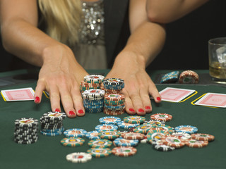 Detail of woman's hands and poker chips