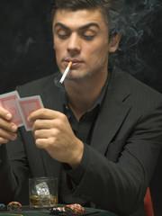 Man smoking at poker game