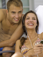 Couple listening to music player