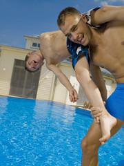 Man and boy playing at pool