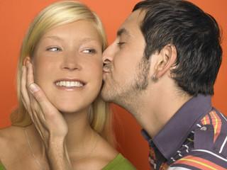 Close-up of man kissing woman