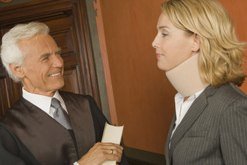 Close-up of a lawyer and a businesswoman looking at each other and smiling