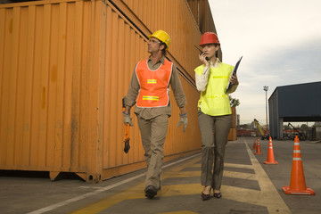 Two dock workers walking at a commercial dock