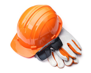 orange hard hat and leather gloves on a white background