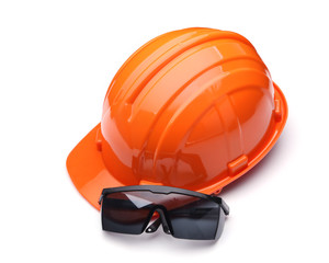 orange safety helmet and goggles on white background