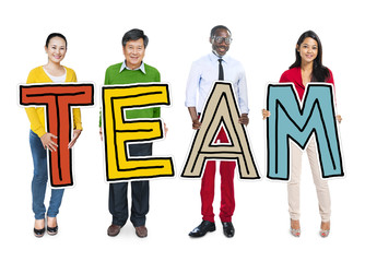 Group of Diverse People Holding Word Team