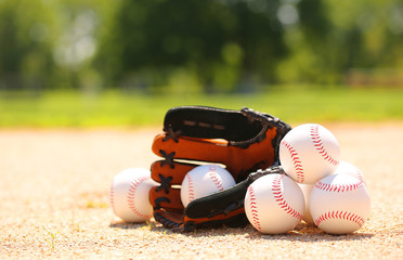 Baseball. Balls and Glove on Field