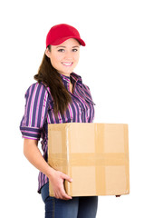 Young happy beautiful delivery girl carrying cardboard box