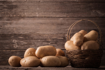 organic potatoes on wooden background
