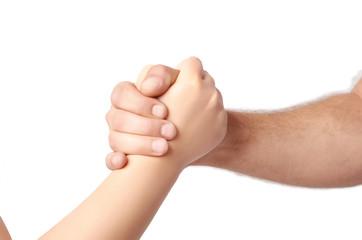Man and child handshake over the white