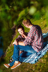 Loving young couple lying in the grass