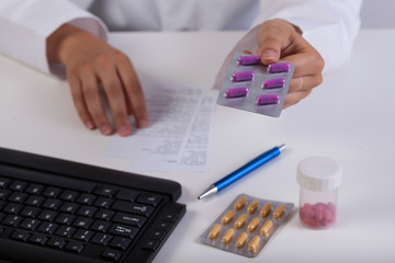 Pharmacist's hands during realizing prescription