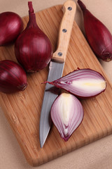 Onions and knife on cutting board