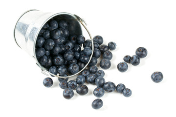 fresh blueberries in a bucket over white