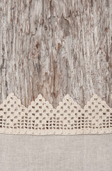 Lace and linen fabric on the old wood