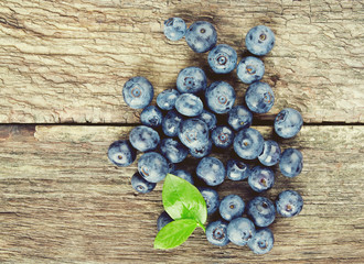 fresh blueberries on wooden surface