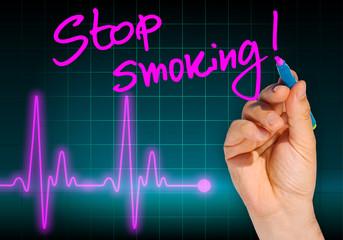 Hand writing message STOP SMOKING