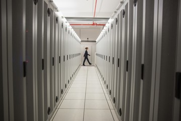 Technician walking in server hallway