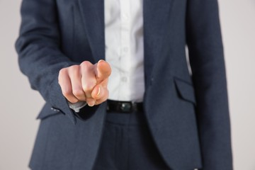 Businesswoman in suit pointing finger