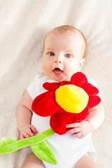 Portrait of a baby with flower