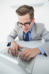 Excited businessman working on laptop