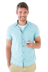 Handsome young man using his smartphone